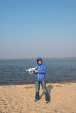 Hobbies and Leisure. Happy woman playing with drone and having f Stock Photography