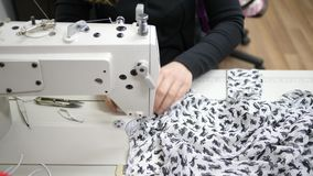 Hobbies and leisure, sewing machine in operation indoors makes fashionable clothes from expensive tissue. Close-up stock video