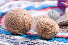 Hobbies series. wool ball. Wool ball on a homemade carpet Royalty Free Stock Photography