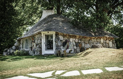Hobbit home. Charlevoix, Michigan, August 8, 2016: one of the unique `hobbit homes` that serve as a local attraction in Charlevoix, MI Royalty Free Stock Photography