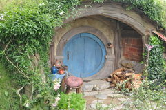 Hobbit house with blue door Royalty Free Stock Photo
