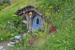 Hobbit house with blue door Royalty Free Stock Photography