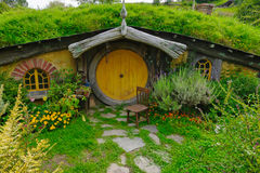 Hobbit house with yellow door Stock Images