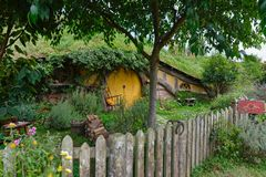 Hobbit house with yellow door Stock Photography