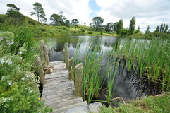Hobbit village lake footbridge Royalty Free Stock Images