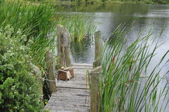 Hobbit village lake footbridge Royalty Free Stock Photography