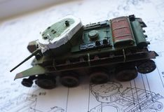 Hobby - Assembly of reduced copies of real battle tanks. Such models are very popular and many fans collect dozens of models at ho. Assembly of reduced copies of royalty free stock image