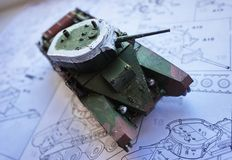 Hobby - Assembly of reduced copies of real battle tanks. Such models are very popular and many fans collect dozens of models at ho. Assembly of reduced copies of royalty free stock images