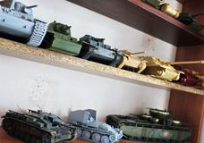 Hobby - Assembly of reduced copies of real battle tanks. Such models are very popular and many fans collect dozens of models at ho. Assembly of reduced copies of stock image
