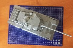 Hobby - Assembly of reduced copies of real battle tanks. Such models are very popular and many fans collect dozens of models at ho. Assembly of reduced copies of royalty free stock photos