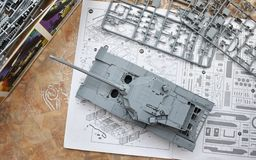 Hobby - Assembly of reduced copies of real battle tanks. Such models are very popular and many fans collect dozens of models at ho. Assembly of reduced copies of stock photos