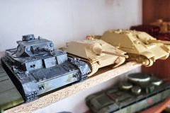 Hobby - Assembly of reduced copies of real battle tanks. Such models are very popular and many fans collect dozens of models at ho. Assembly of reduced copies of royalty free stock photo