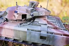 Hobby - Assembly of reduced copies of real battle tanks. Such models are very popular and many fans collect dozens of models at ho. Hobby - Assembly of reduced stock image
