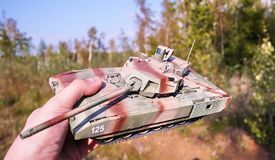 Hobby - Assembly of reduced copies of real battle tanks. Such models are very popular and many fans collect dozens of models at ho. Hobby - Assembly of reduced royalty free stock photos