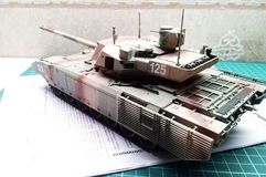 Hobby - Assembly of reduced copies of real battle tanks. Such models are very popular and many fans collect dozens of models at ho stock illustration