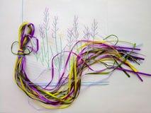 Hobby colorato della serva dei nastri del ricamo immagini stock