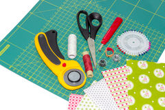 Hobby composition of quilting instruments, items and fabrics Royalty Free Stock Photo
