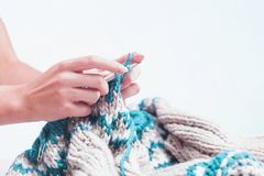 The hobby concept - knitting. The hobby concept - The knitting in female hands Stock Image