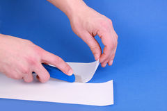 Hobby knife cutting paper Royalty Free Stock Images