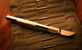 Hobby knife. On wood table Royalty Free Stock Image