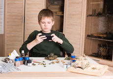 Hobby and leisure concept. Teen boy with smartphone taking pictu Stock Photos