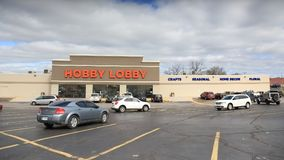 Hobby Lobby store in Springfield, MO, on April 14, 2018. A Hobby lobby retail store on a cloudy day with people and cars in the parking lot in the foreground royalty free stock images