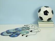 Hobby: musik och fotboll royaltyfria bilder