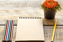Hobby painting - workplace with colored pencils, blank open notebook Royalty Free Stock Images