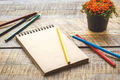 Hobby painting - workplace with colored pencils, blank open notebook Royalty Free Stock Image