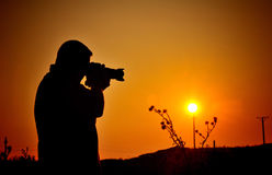 Hobby photographer silhouette. Silhouette of a hobby photographer in the sunset - copy space Royalty Free Stock Photo