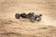 Hobby radio-controlled car racing. On a desert summer day royalty free stock photos