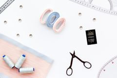 Hobby sewing with thread, scissors, fabric. Lifestyle. White background top view stock photos