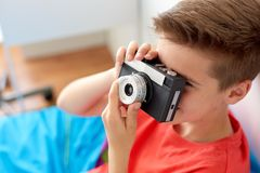 Close up of boy photographing by film camera Royalty Free Stock Images