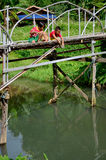 Hobby of thai children people in holiday is fishing at Baan Nato. Hobby of thai children people in holiday is fishing on Bamboo bridge at Baan Natong village on Stock Images