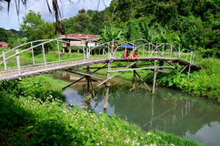 Hobby of thai children people in holiday is fishing at Baan Nato. Hobby of thai children people in holiday is fishing on Bamboo bridge at Baan Natong village on Stock Photography