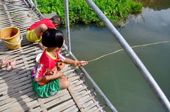 Hobby of thai children people in holiday is fishing at Baan Nato. Hobby of thai children people in holiday is fishing on Bamboo bridge at Baan Natong village on Royalty Free Stock Photo