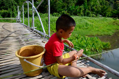 Hobby of thai children people in holiday is fishing at Baan Nato. Hobby of thai children people in holiday is fishing on Bamboo bridge at Baan Natong village on Stock Photos