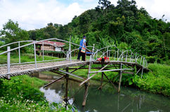 Hobby of thai children people in holiday is fishing at Baan Nato. Thai women portrait with children fishing on Bamboo bridge at Baan Natong village on August 30 Stock Photo