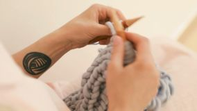 Hobby time. Knitting on knitting needles is a fashionable hobby. Video footage. Hobby time. Knitting on knitting needles is a meditation fashionable hobby. Video stock footage