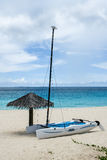 Hobie cat and beach umbrella, Anguilla, British West Indies, BWI, Caribbean Royalty Free Stock Images