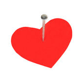Hobnail in a red heart Stock Photos