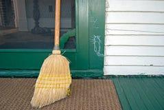 Hobo cat sign on door. Hobo cat sketch on door jamb with old broom royalty free stock images
