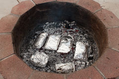 Hobo dinners. Image of hobo / tin foil dinners on the campfire Stock Photography