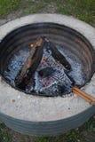 Hobo pie cooking. In the coals stock images