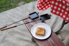 Hobo Pie. Toasted hobo pie on a picnic table bench stock photo