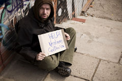 Hobo with placard Royalty Free Stock Photos