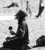 Hobo Selling Items. Homeless man on beach, Santa Barbara, CA October 2014, selling handmade items Royalty Free Stock Photos