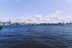 View over Manhattan and the Hudson river from Hoboken rivereside. HOBOKEN, NJ - SEPTEMBER 10TH, 2017: View over Manhattan and the Hudson river from Hoboken Royalty Free Stock Photos
