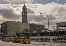 Eerie Lackawanna Clock Tower. Hoboken , NJ USA -- September 19, 2017 -- Taxi cabs and bikes lines up outside the Hoboken train station and clock tower. Editorial stock photos