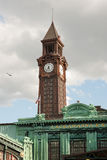 Hoboken terminal clock tower. Warrington Plaza and clock tower of Hoboken terminal building Royalty Free Stock Image